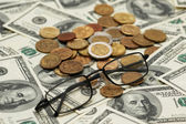 American dollars, reading glasses — Stock Photo