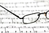 Glasses over the music sheets — Stock Photo