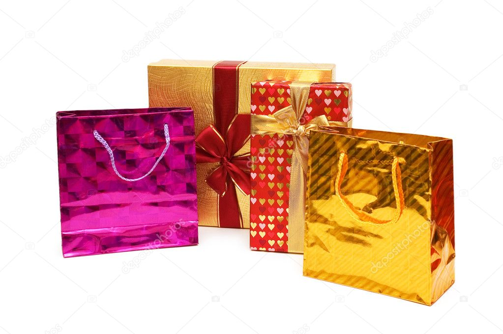 Shopping bags and giftbox isolated on the white — Stock Photo #2683494