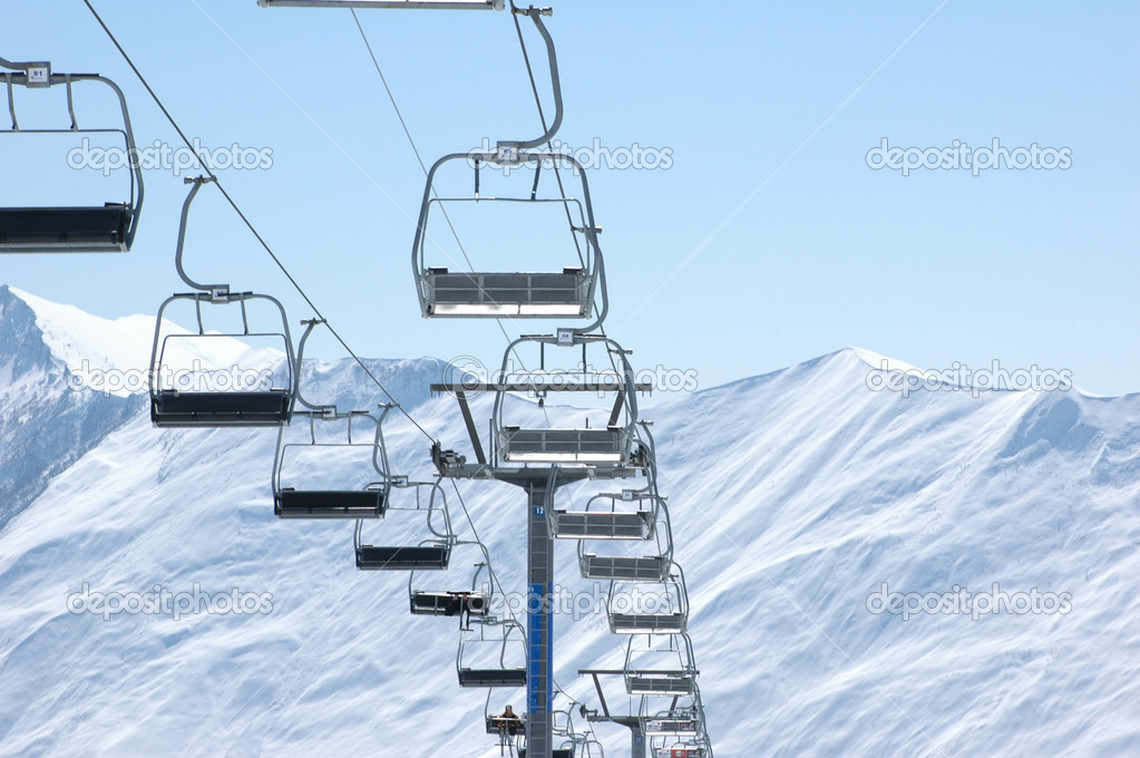 Ski lift chairs on bright winter day — Stock Photo #2685958