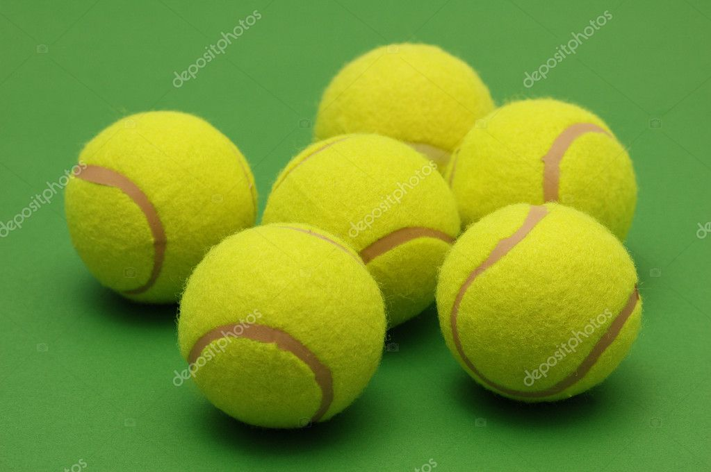 Big tennis balls on the green background — Stock Photo #2686642