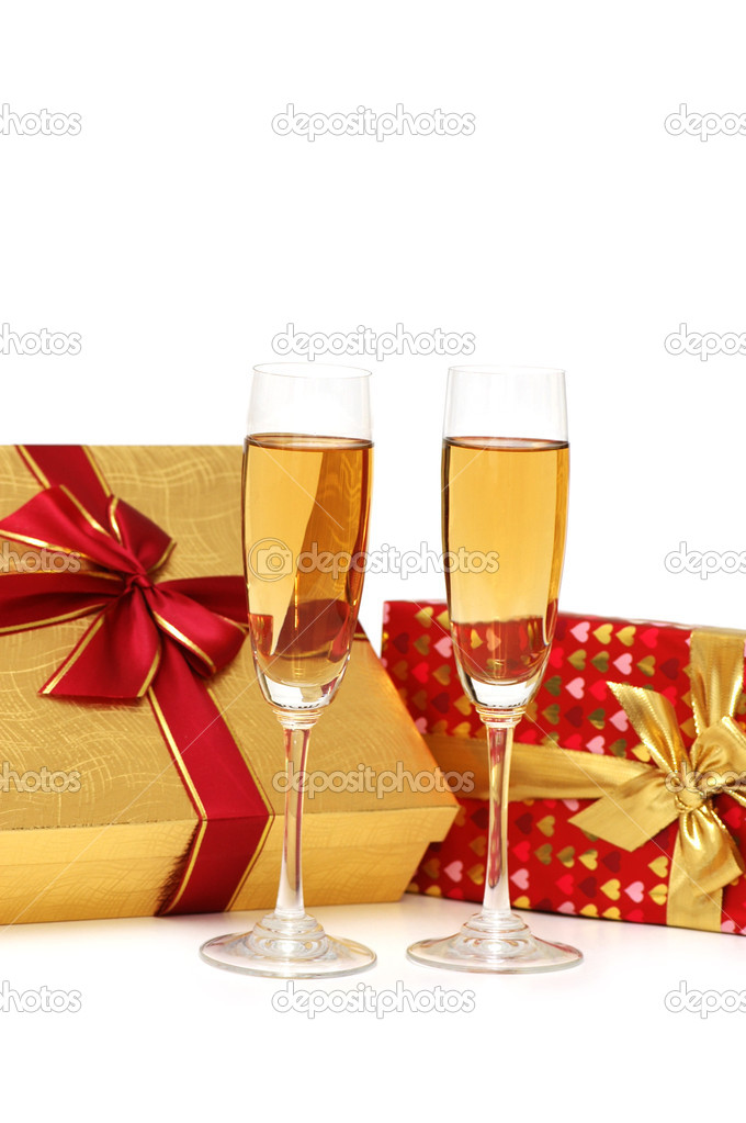 Giftboxes and champagne isolated on the  white — Stock Photo #2686726