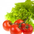 Ripe red tomatoes and green leaves of sa — Stock Photo