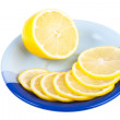 Stock Photo: Ripe yellow lemon on dark blue saucer