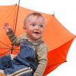 Little boy and orange umbrella — Stock Photo