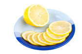 Ripe yellow lemon on dark blue saucer — Stock Photo