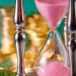 Hourglass and coins — Foto de Stock