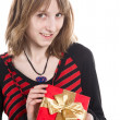 Young girl with a gift — Stock Photo