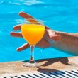 Stock Photo: Hand and glass with orange juice