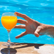 Man's hand and glass with orange juice — Stock Photo