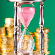 Hourglass and coins — Lizenzfreies Foto
