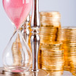 Hourglass and coins — Stock Photo #2060302