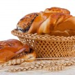 Royalty-Free Stock Photo: Buns with cinnamon and wheat ears.