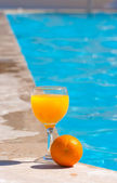 Orange and glass with orange juice — Stock Photo
