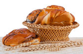 Buns with cinnamon and wheat ears. — Stock Photo