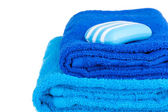 Blue terry towels and soap — Stock Photo