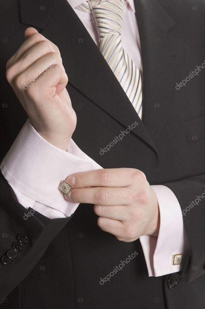 The man in a business suit corrects a cuff link — Foto Stock #2060188