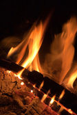 Flame and fire wood burning in a fire — Stock Photo