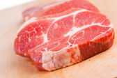 Meat on chopping board — Stock Photo