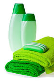 Green terry towels, soap and shampoo — Stock Photo