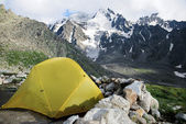 Yellow tent in the Caucasus — Stock Photo