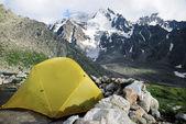 Yellow tent in the Caucasus — Stock Photo