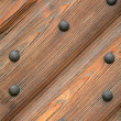 Door with metal rivets — Stock Photo