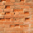 Wall from a red brick — Stock Photo