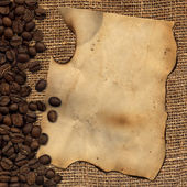 Old paper on background with coffee — Stockfoto