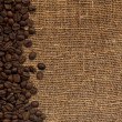 Card with coffee beans on background fro — Stock Photo