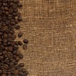Card with coffee beans on background fro — Stock Photo #1238198