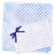 Stock Photo: Blue background with note paper and bow