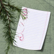 Sheet with christmas tree on background — Stock Photo