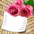 Card with roses on grunge background — Stock Photo