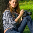 The girl-photographer in spring park — Stock Photo #1318945