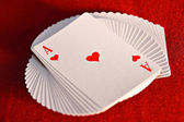 The pack of the playing cards which have been spread out by a fan — Stock Photo