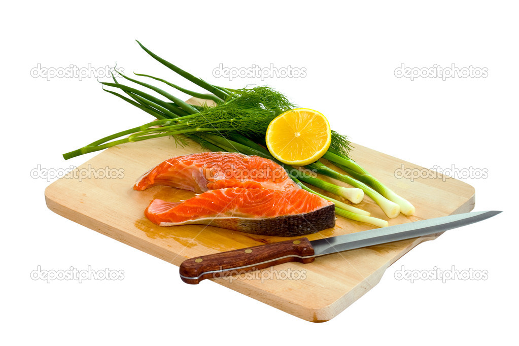 Fresh salmon steak with spring onions on board — Stock Photo #1326598