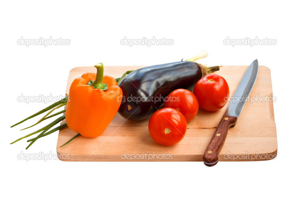 Eggplant, tomatoes, Bulgarian pepper with knife  in a board on a white background — Stock Photo #1328088