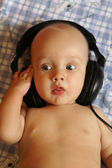 Baby with phones — Stock Photo