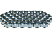 Many screw nuts on white — Stock Photo