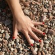 Stock Photo: Arm and pebbles 1