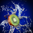 Kiwi in water splash - Stock Photo