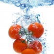 Tomato splashing in water — Stock Photo
