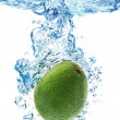 Royalty-Free Stock Photo: Avocado splashing in water