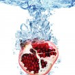 Royalty-Free Stock Photo: Pomegranate splashing in water