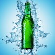 Foto Stock: Beer bottle being poured in a water