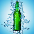 Stock Photo: Beer bottle being poured in water