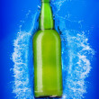 Beer bottle in water — Stock Photo #1337643