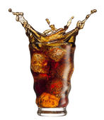 Cola splashing — Stock Photo