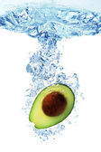 Avocado splashing in water — Stock Photo